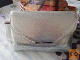 dve srebrni torbici